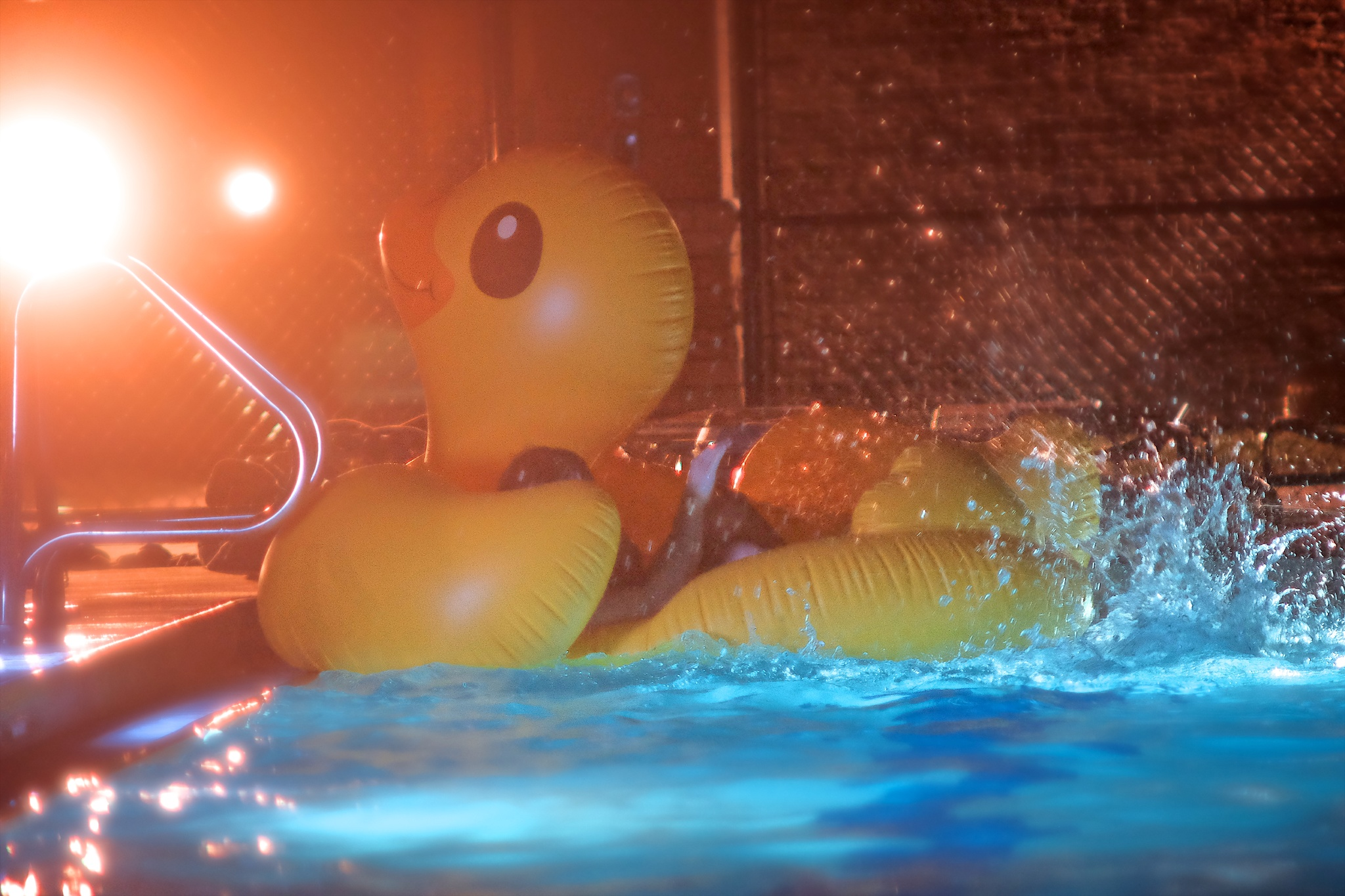No after-hours pool party is complete without a large rubber duck. Taken from the set of Nick Brennan's music video Buck Naked