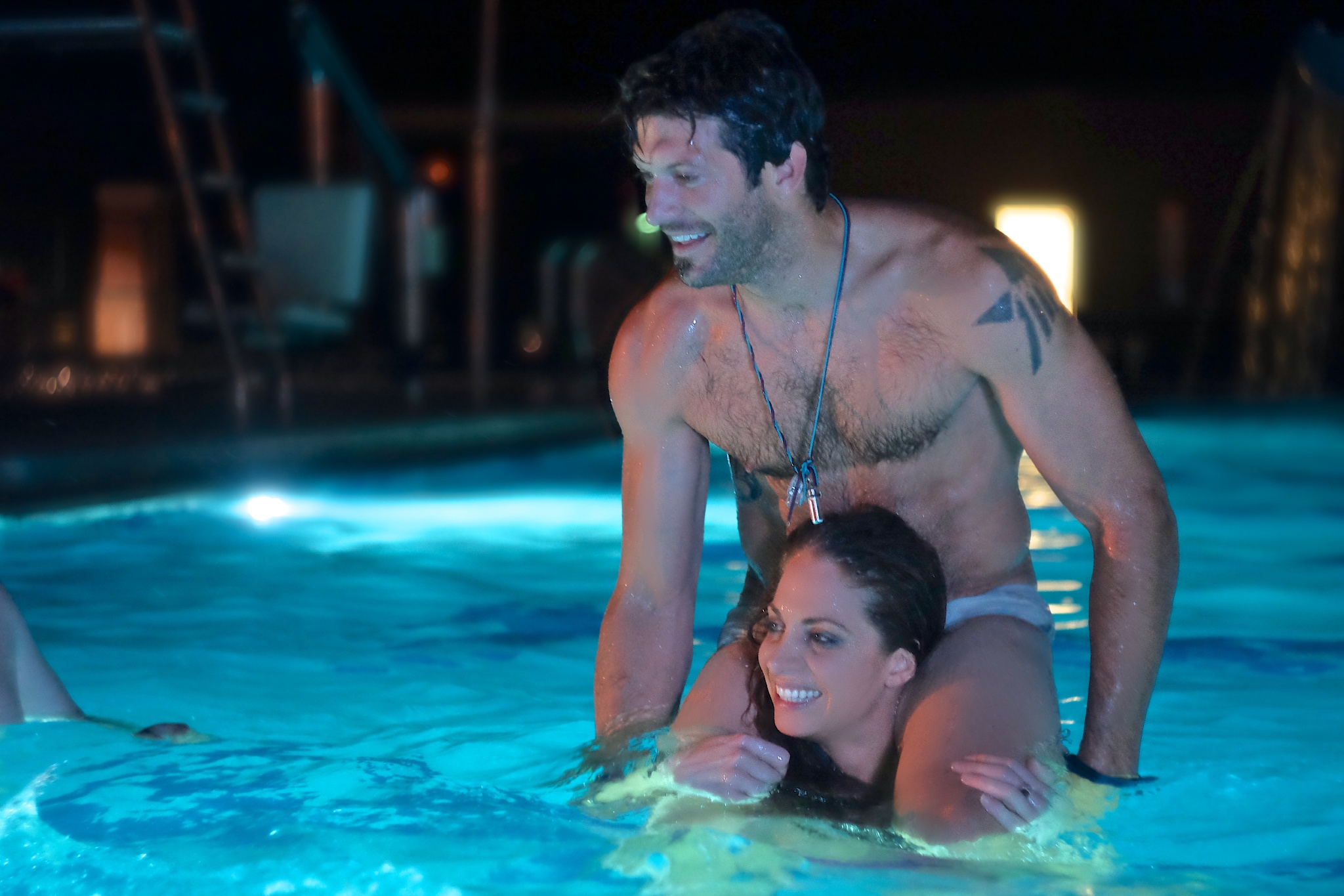 Supporting actors Vanessa Boyer and Lance Salsgiver relaxing in the pool on the Buck Naked set